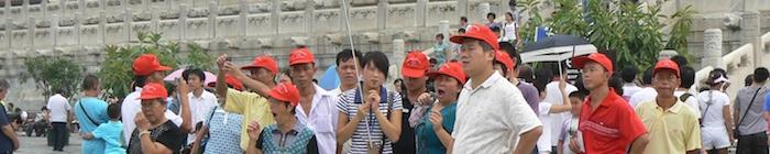 Een groep Chinezen bezoekt de Verboden Stad in Beijing